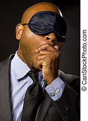 Businessman Wearing an Eye Mask - Sleepy businessman wearing...