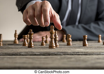 Businessman wearing business suit playing a game of chess