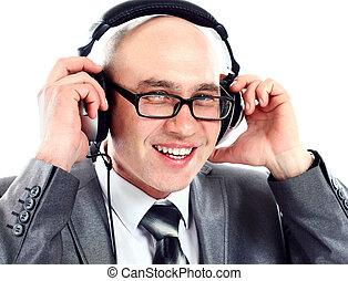 Businessman wearing earphone struggling to hear....