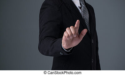 Businessman wearing  suite pointing finger