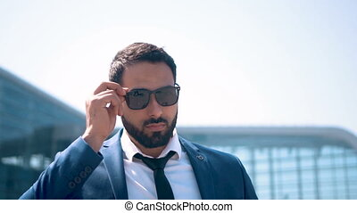 Businessman Wearing Sunglasses - Bearded sexy businessman...
