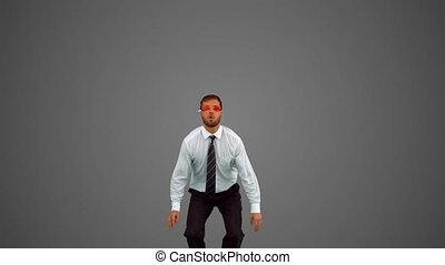 Businessman wearing swimming goggles jumping on grey background in slow motion