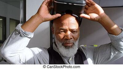 Businessman wearing virtual reality headset 4k - Businessman...