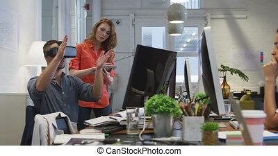 Businessman wearing VR helmet in modern office - Front view ...