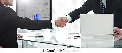 businessman welcomes business partner shaking hands