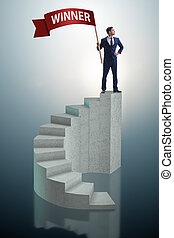 Businessman winner on top of staircase