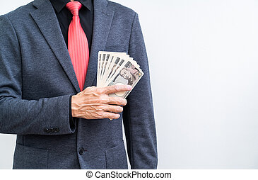 Businessman wite ten thousand yen banknote on white background