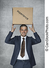 businessman with a box of experience