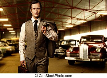 Businessman with a briefcase in garage