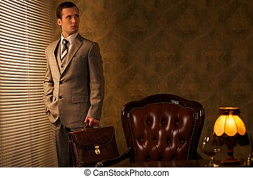 Businessman with a briefcase in retro interior
