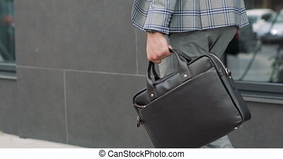 Businessman with a briefcase Walking on Streets of Business District