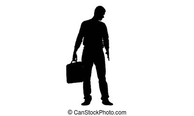 Businessman with a case in his hands is nervous and looks at his wristwatch. Silhouette. White background