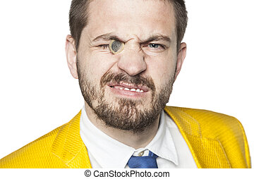 businessman with a coin in the eye