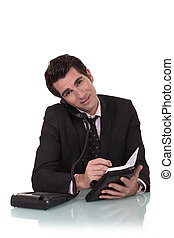 Businessman with a diary and phone