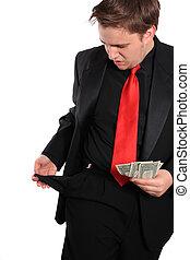 Businessman with a few dollars