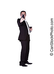 Businessman with a glass of drink taking a picture -...