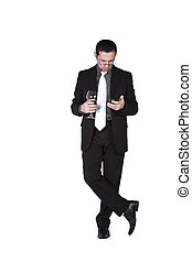 Businessman with a glass of drink texting - Isolated...