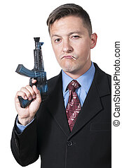 Businessman with a gun