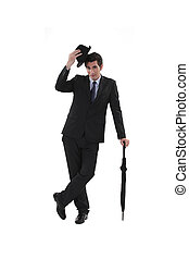 Businessman with a hat and umbrella
