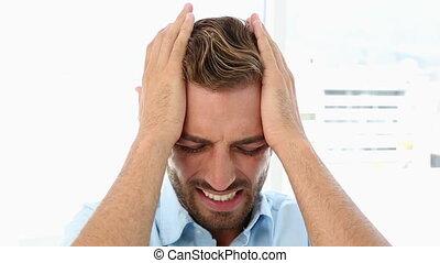 Businessman with a headache shakin - Businessman with a...
