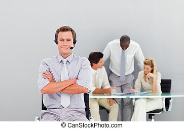 Businessman with a headset on looking at the camera