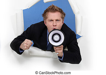 Businessman with a loudspeaker