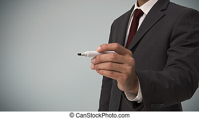 Businessman with a marker