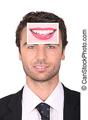 Businessman with a photo of a woman's lips on his forehead