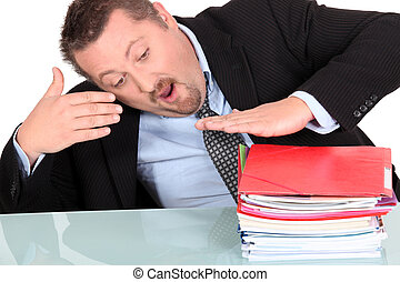 Businessman with a pile of paperwork