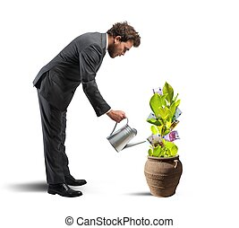 Businessman with a plant of money - Concept of easy earn...