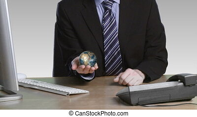 Businessman with a rotary globe in his hand - Businessman on...
