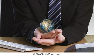 Businessman with a rotary globe in his hand - Closer view of...