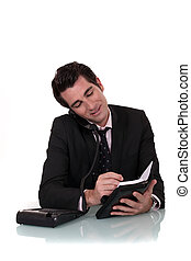 Businessman with a telephone and diary