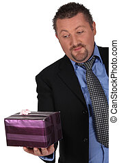 Businessman with a wrapped gift
