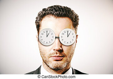 businessman with abstract glasses clock