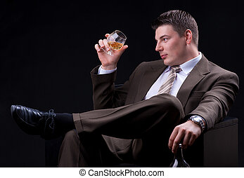 Businessman with alcoholic drink