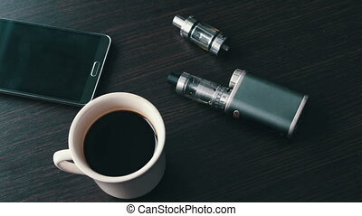 businessman with an e-cigarette on the stylish table