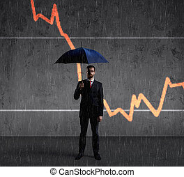 Businessman with an umbrella on a diagram
