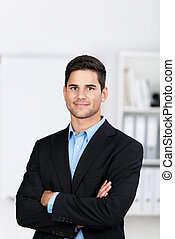Businessman With Arms Crossed In Office