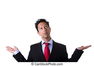 businessman with arms up and open hands looking to the copypace (isolated on white)