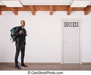"Businessman with backpack forward to a door with ""Success"""