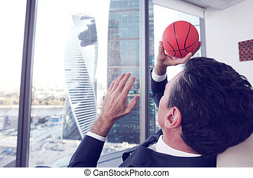 Businessman with basketball