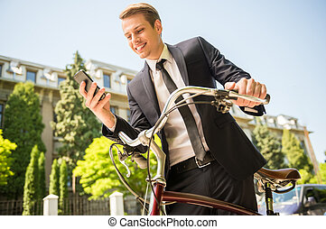 Businessman with bicycle