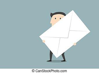 Businessman with big paper postal envelope