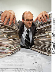 Businessman with big piles of paperwork - Portrait of...