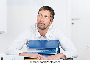 Businessman With Binders In Office