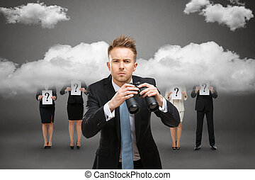 Businessman with binocular against stormy sky
