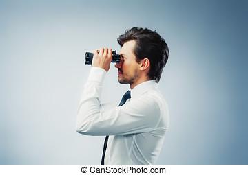 Businessman with binocular