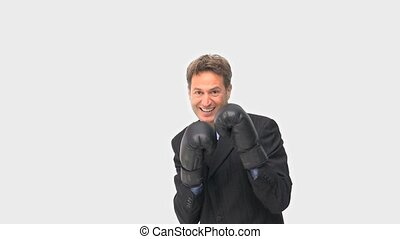 Businessman with black boxing gloves