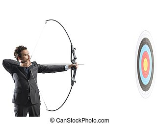 Businessman with bow and arrow - Concept of determination in...